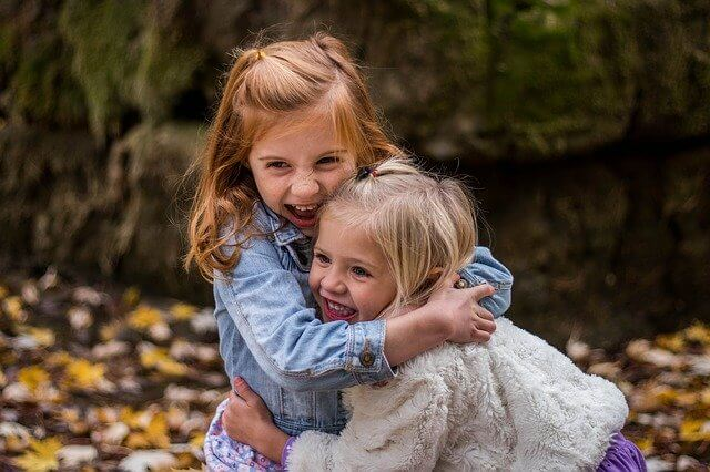 A picture of friendship. Girls hugging.